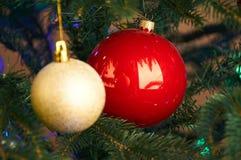 Two balls on Christmas tree Royalty Free Stock Image