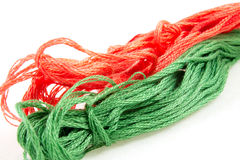 Two balls of cotton green and red Stock Photos