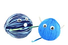 Two Balls Of Crochet Yarn Funny Faces Stock Images