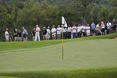 Two Balls on the Green, with Flag Pole. Both palyers balls made it to the green, separated by the flag pole Stock Photo