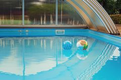 Two balls left alone on water surface in blue pool royalty free stock photos