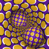 Two balls are moving in golden purple polka dots rotating hole Royalty Free Stock Photography