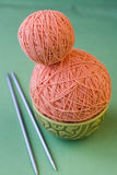 Two balls of pink yarn and knitting needles Stock Photography