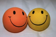 Two balls with smiles close-up Stock Images