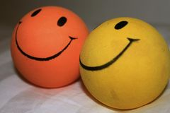 Two balls with smiles close-up view from the side Royalty Free Stock Images