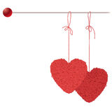 Two balls of threads in the form of heart hanging Royalty Free Stock Photo