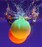 Two balls in water. Two colorful balls submerged in water stock images