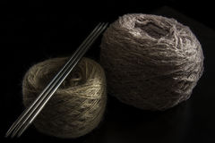 Two balls of wool. And needles on a black background. yarn of isolated Royalty Free Stock Photos