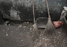Two bamboo broom stick and a scoop lay down on the ground photo taken in Jakarta Indonesia Royalty Free Stock Photography