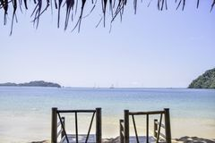 Two Bamboo chair by the sea for seat to see view royalty free stock photo
