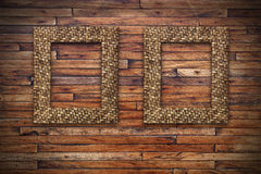Two bamboo frames on wood wall Royalty Free Stock Image