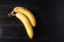 Two bananas on dark background Stock Photo