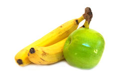 Two bananas and green apple. Composition Royalty Free Stock Image