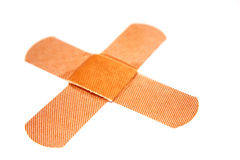 Two band-aids in cross shape stock images