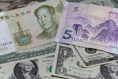 Banknotes of Chinese yuan against background of american dollars. Two banknotes of Chinese yuan against background of american dollars stock photos