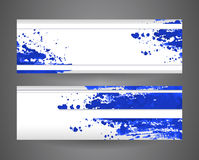 Two banners with blue abstract spray paint. Crumpled paper background. Stock Photography