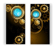 Two banners with gears. Two banners with gold and brass gears on a dark background Stock Image