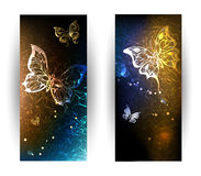 Two banners with glowing butterflies. Two vertical banner with glowing nocturnal butterflies on a black background Stock Images