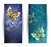 Two banners with gold butterflies. Two vertical rectangular banner with gold butterflies on a blue background Royalty Free Stock Photos