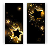 Two banners with gold stars. Two vertical banner with shiny gold stars on a black background Royalty Free Stock Image
