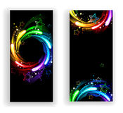 Two banners with rainbow stars. Two vertical banners with rainbow stars on a black background Stock Image