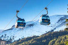 Two Bansko cable car cabins and snow mountains Stock Images