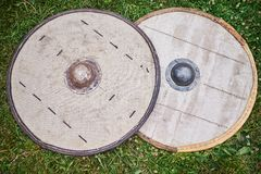 Two barbarian shields on the ground royalty free stock images