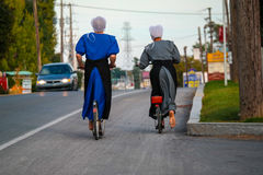 Two Barefoot Amish Women on Bikes Royalty Free Stock Photography
