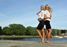 Two barefoot girls on river bank Stock Images