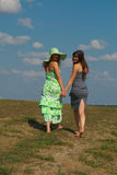 Two barefooted girls on the hill Stock Photos