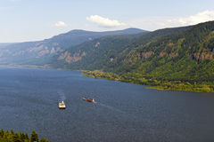 Two barges on the Columbia River with the hilly banks Royalty Free Stock Photos