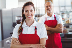 Two baristas smiling at the camera with arms crossed. At the cafe Stock Photography