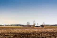 Two Barns On An Early Spring Field Royalty Free Stock Images