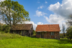 Two barns. Tranquil village scenery - two barns under a cloudy summer sky Stock Photo