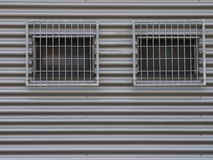 Two barred windows Stock Photos