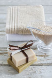 Two bars of handmade soap, sea salt and soft towels on  wood Stock Photos