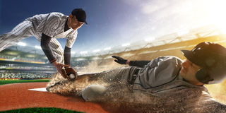 Two baseball player in action. Two baseball player the in action on grand arena Royalty Free Stock Photos
