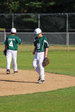 Pre-game jitters. Two high school baseball players getting ready to warmup for their game at a school in Salem, Oregon in May  2011 Stock Photography