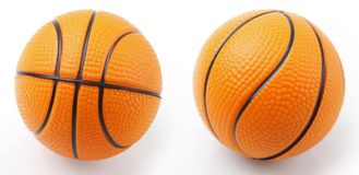 Two basket balls. Two basketballs on plain background Royalty Free Stock Image