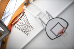 Two basketball hoops in sport school gym hall Stock Image