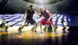 Two basketball players action in the gym Royalty Free Stock Photo