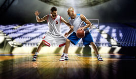 Two basketball players action in the gym Royalty Free Stock Photography
