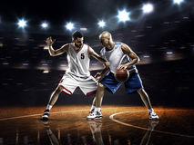 Two basketball players in action Royalty Free Stock Images