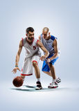 Two basketball players in action. Isolated on white  two basketball players in action Stock Photography