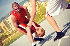 Two basketball players on the court Stock Photos