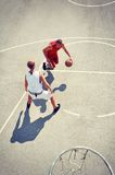 Two basketball players on the court stock image