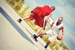 Two basketball players on the court Royalty Free Stock Photography