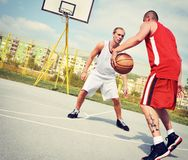 Two basketball players on the court Stock Images