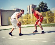 Two basketball players on the court Stock Photo