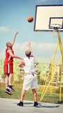 Two basketball players on the court Royalty Free Stock Photos